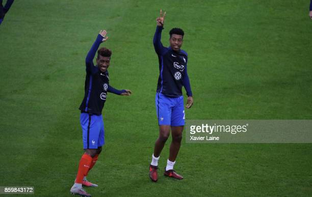 Kingsley Coman and Presnel Kimpembe of France react before the FIFA 2018 World Cup Qualifier between France and Netherlands at Stade de France on...