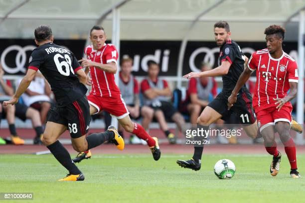 Kingsley Coman and Rafinha of FC Bayern Muenchen in action against Patrick Cutrone of AC Milan during the 2017 International Champions Cup football...