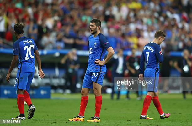 Kingsley Coman AndrePierre Gignac and Antoine Griezmann of France show their dejection after Portugal's first goal during the UEFA EURO 2016 Final...