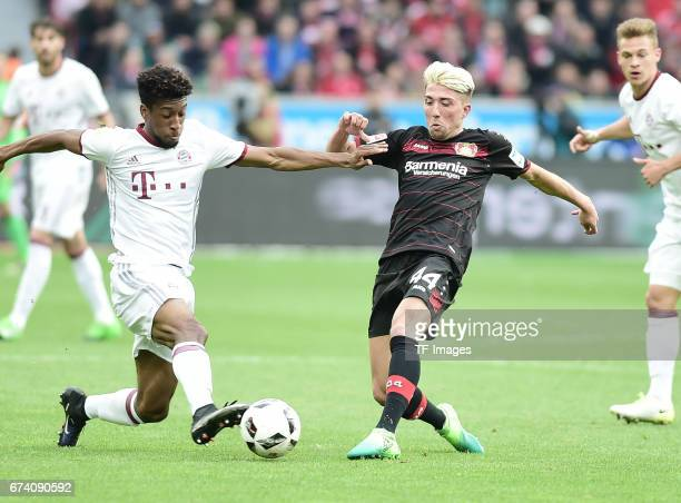 Kingsley Coman Kevin Kampl of Leverkusen battle for the ball during the Bundesliga match between Bayer 04 Leverkusen and Bayern Muenchen at BayArena...