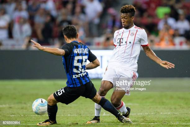 Kingsley Coman of Bayern dribbles FC Internazionale Defender Yuto Nagatomo during the International Champions Cup match between FC Bayern and FC...