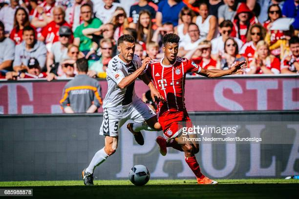 Kingsley Coman of Bayern Muechnen fights for the ball with Manuel Gulde of Freiburg during the Bundesliga match between Bayern Muenchen and SC...