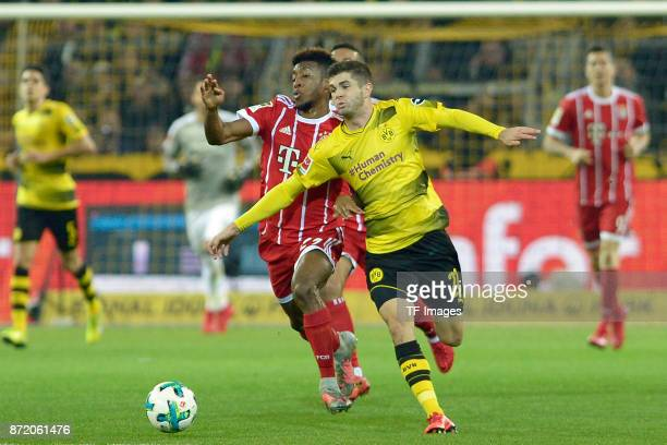 Kingsley Coman of Bayern Muenchen and Christian Mate Pulisic of Dortmund battle for the ball during the German Bundesliga match between Borussia...