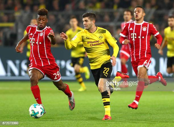 Kingsley Coman of Bayern Muenchen and Christian Pulisic of Dortmund Thiago Alcantara do Nascimento of Bayern Muenchen battle for the ball during the...