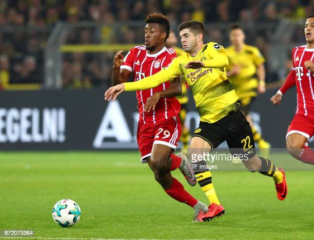 Kingsley Coman of Bayern Muenchen and Christian Pulisic of Dortmund battle for the ball during the German Bundesliga match between Borussia Dortmund...