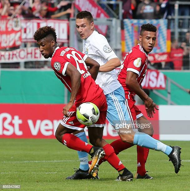 Kingsley Coman of Bayern Muenchen and Daniel Frahn of Chemnitz and Corentin Tolisso of Bayern Muenchen battle for the ball during the DFB Cup first...