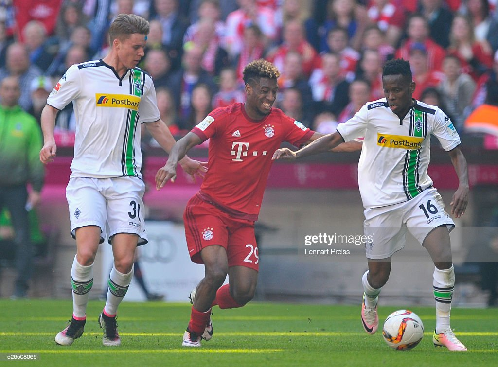 Kingsley Coman of Bayern Muenchen and Ibrahima Traore of Borussia Moenchengladbach compete for the ball during the Bundesliga match between Bayern Muenchen and Borussia Moenchengladbach at Allianz Arena on April 30, 2016 in Munich, Germany.