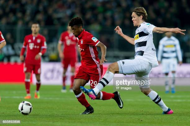 Kingsley Coman of Bayern Muenchen and Jannik Vestergaard of Borussia Moenchengladbach battle for the ball during the Bundesliga match between...