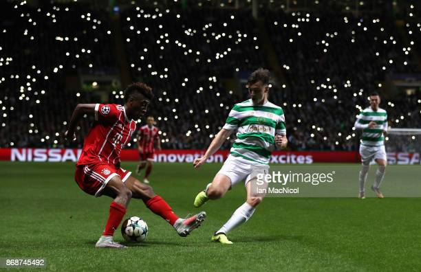 Kingsley Coman of Bayern Muenchen and Kieran Tierney of Celtic battle for the ball during the UEFA Champions League group B match between Celtic FC...
