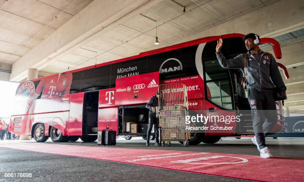 Kingsley Coman of Bayern Muenchen arrives next to the team bus prior to the Bundesliga match between Bayern Muenchen and Borussia Dortmund at Allianz...