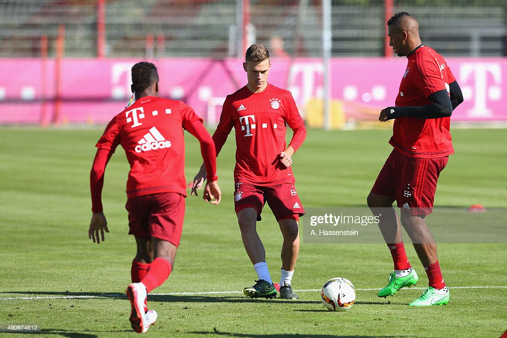 Kingsley Coman (L) of Bayern Muenchen battles for the ball with his team mates Josuhua Kimmich and Jerome Boateng (R) during a training session at Bayern Muenchen's trainings ground Saebener Strasse on October 2, 2015 in Munich, Germany.