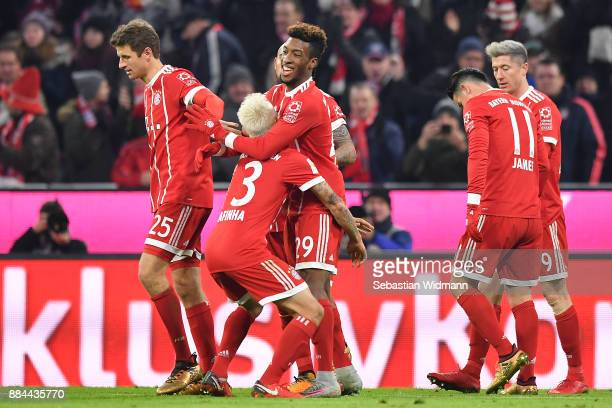 Kingsley Coman of Bayern Muenchen celebrates with Rafinha of Bayern Muenchen after he scored a goal to make it 21 during the Bundesliga match between...