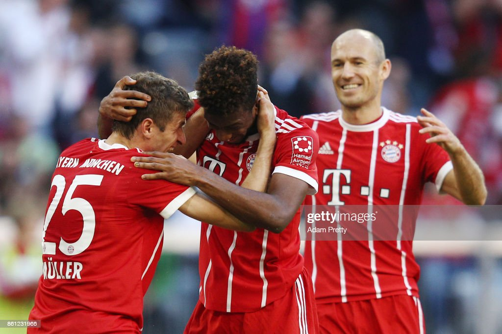 Kingsley Coman of Bayern Muenchen (r) celebrates with Thomas Mueller of Bayern Muenchen after he scored his teams second goal to make it 2:0 during the Bundesliga match between FC Bayern Muenchen and Sport-Club Freiburg at Allianz Arena on October 14, 2017 in Munich, Germany.