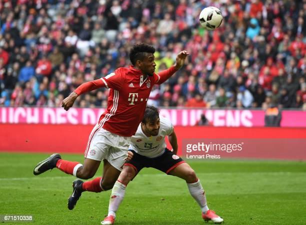 Kingsley Coman of Bayern Muenchen challenges Giulio Donati of 1 FSV Mainz 05 during the Bundesliga match between Bayern Muenchen and 1 FSV Mainz 05...