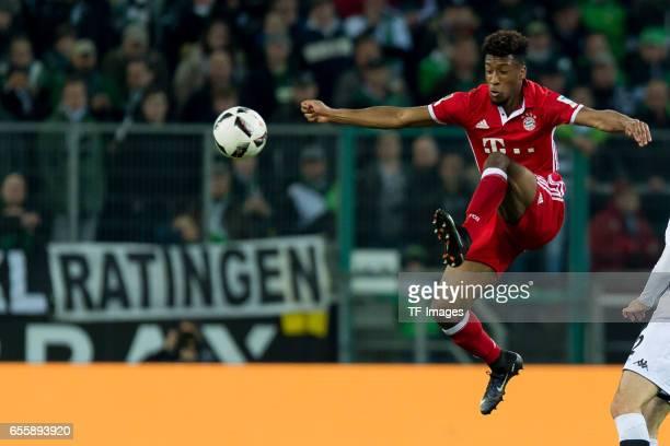 Kingsley Coman of Bayern Muenchen controls the ball during the Bundesliga match between Borussia Moenchengladbach and Bayern Muenchen at BorussiaPark...
