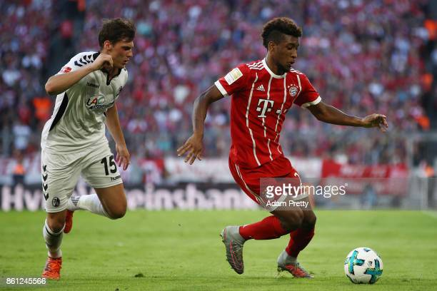 Kingsley Coman of Bayern Muenchen runs with Pascal Stenzel of Freiburg during the Bundesliga match between FC Bayern Muenchen and SportClub Freiburg...