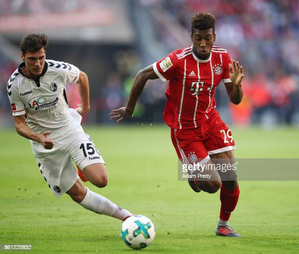 Kingsley Coman of Bayern Muenchen runs with the ball against Pascal Stenzel of Freiburg during the Bundesliga match between FC Bayern Muenchen and...