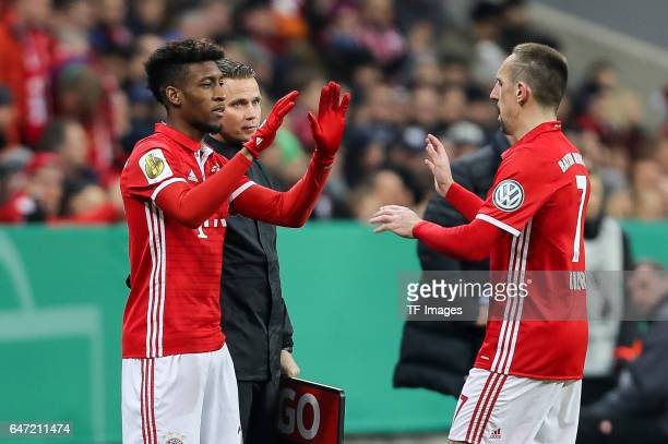 Kingsley Coman of Bayern Muenchen shakes hands with Franck Ribery of Bayern Muenchen during the DFB Cup quarter final between Bayern Muenchen and FC...