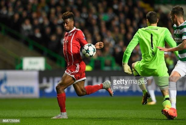 Kingsley Coman of Bayern Muenchen takes the ball around the keeper on his way to scoring the first goal during the UEFA Champions League group B...
