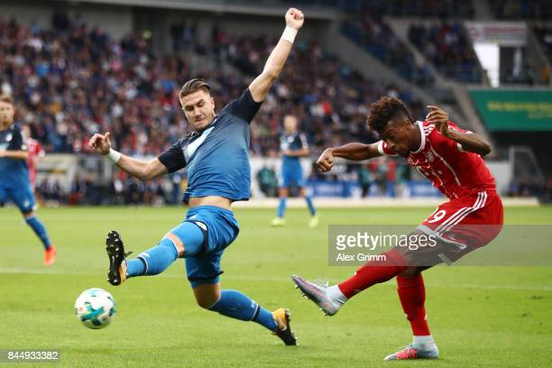 Kingsley Coman of Bayern Muenchen with Ermin Bicakcic of Hoffenheim during the Bundesliga match between TSG 1899 Hoffenheim and FC Bayern Muenchen at...