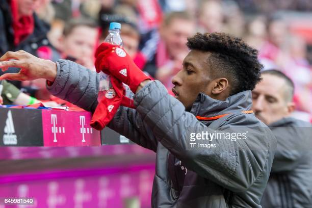 Kingsley Coman of Bayern Muenchen writes autograms during the Bundesliga match between Bayern Muenchen and Hamburger SV at Allianz Arena on February...