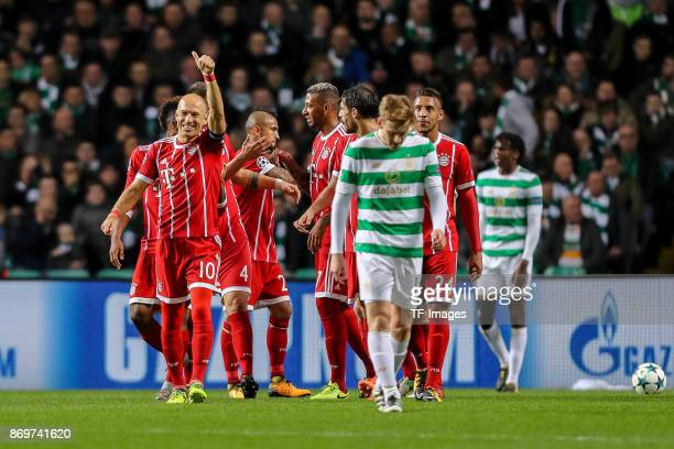 Kingsley Coman of Bayern Munich celebrates after scoring his team`s first goal with team mates and Arjen Robben of Bayern Munich celebrates...