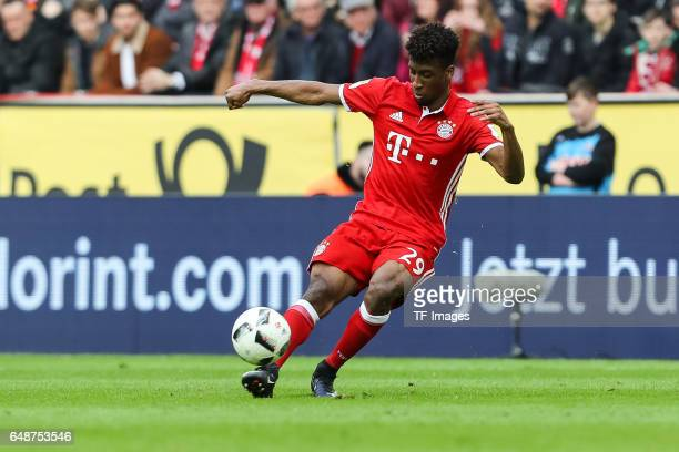 Kingsley Coman of Bayern Munich controls the ball during the Bundesliga match between 1 FC Koeln and Bayern Muenchen at RheinEnergieStadion on March...