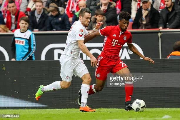 Kingsley Coman of Bayern Munich und Christian Clemens of Cologne battle for the ball during the Bundesliga match between 1 FC Koeln and Bayern...
