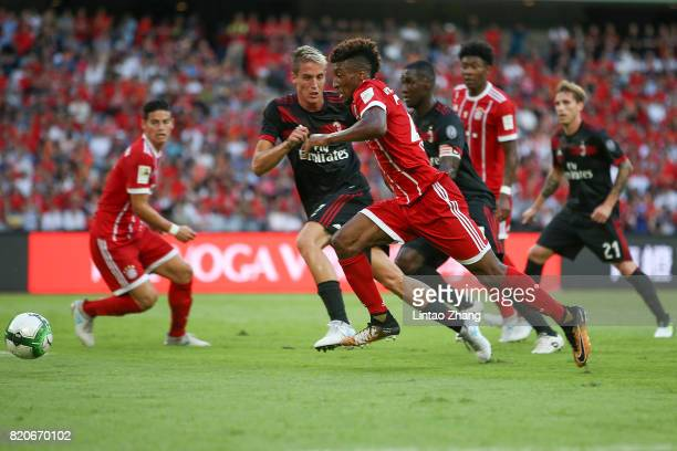 Kingsley Coman of FC Bayern competes for the ball with Andrea Conti of AC Milan during the 2017 International Champions Cup China match between FC...