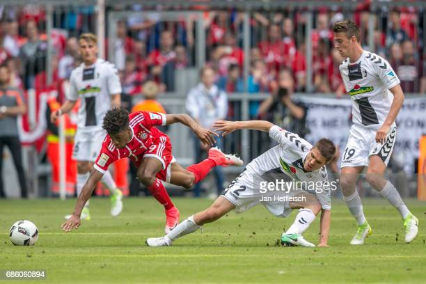 Kingsley Coman of FC Bayern Muenchen and Aleksandar Ignjovski of SC Freiburg fight for the ball during the Bundesliga match between Bayern Muenchen...