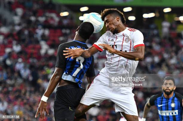 Kingsley Coman of FC Bayern Muenchen and Gary Medel of FC Interernazionale competes for the ball during the International Champions Cup match between...