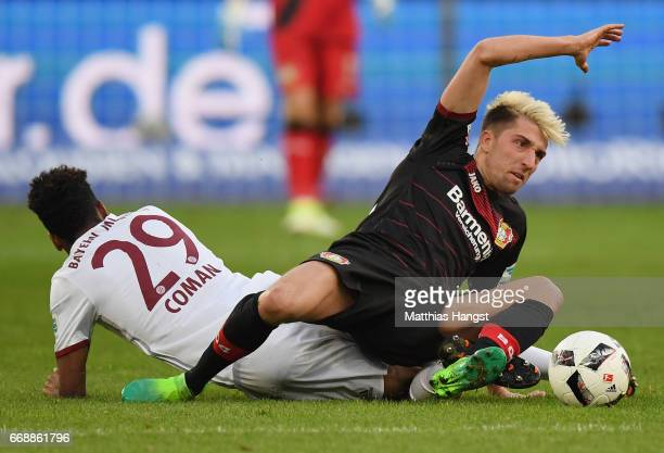 Kingsley Coman of FC Bayern Muenchen and Kevin Kampl of Leverkusen compete for the ball during the Bundesliga match between Bayer 04 Leverkusen and...