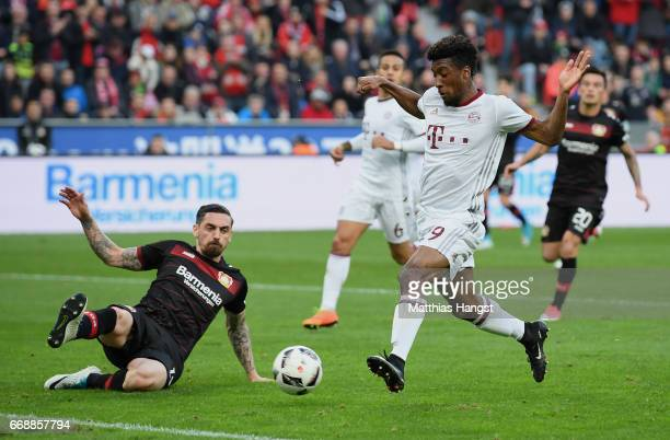 Kingsley Coman of FC Bayern Muenchen is challenged by Roberto Hilbert of Leverkusen during the Bundesliga match between Bayer 04 Leverkusen and...