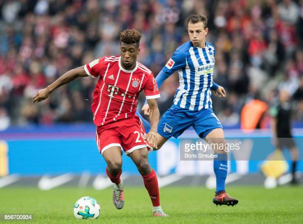 Kingsley Coman of FC Bayern Muenchen is challenged by Vladimir Darida of Hertha BSC during the Bundesliga match between Hertha BSC and FC Bayern...