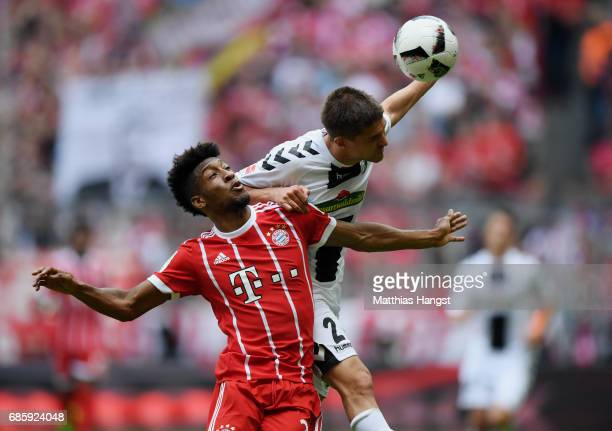 Kingsley Coman of FC Bayern Muenchen jumps for a header with Aleksandar Ignjovski of Freiburg during the Bundesliga match between Bayern Muenchen and...