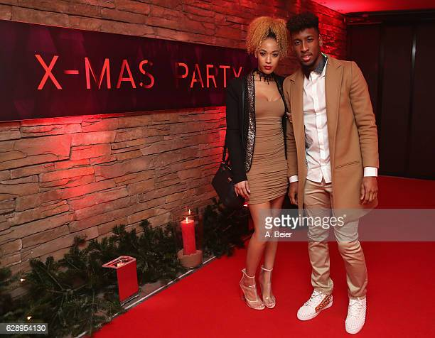 Kingsley Coman of FC Bayern Muenchen poses with his wife Sephora as they arrive for the club's Christmas party at H'ugo's bar on December 10 2016 in...