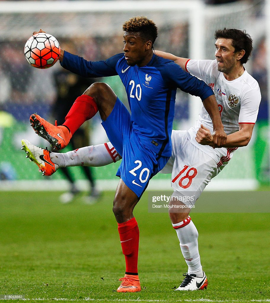 Kingsley Coman of France battles for the ball with Yuri Zhirkov of Russia during the International Friendly match between France and Russia held at Stade de France on March 29, 2016 in Paris, France.