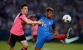 Kingsley Coman of France is challenged by Charlie Mulgrew of Scotland during the International Friendly between France and Scotland on June 4 2016 in...