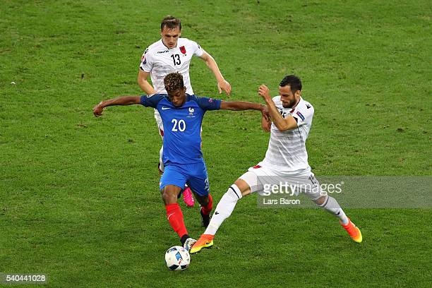 Kingsley Coman of France is closed down by Mergim Mavraj of Albania during the UEFA EURO 2016 Group A match between France and Albania at Stade...