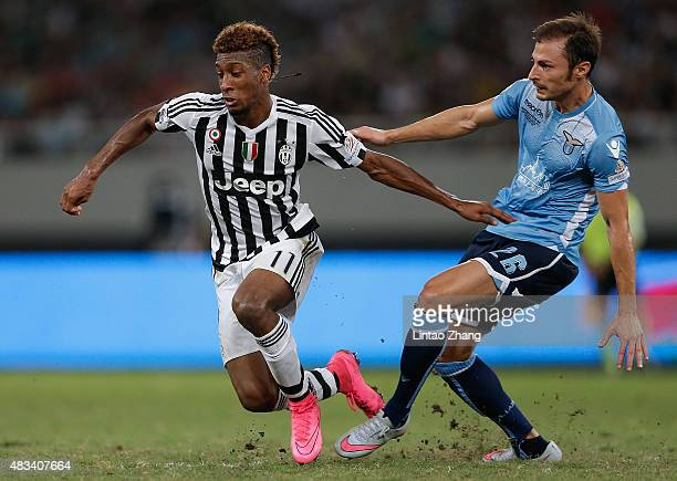 Kingsley Coman of Juventus FC challenges Stefan Radu of Lazio during the Italian Super Cup final football match between Juventus and Lazio at...