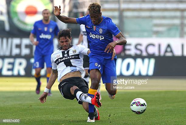 Kingsley Coman of Juventus FC competes for the ball with Pedro Mendes of Parma FC during the Serie A match between Parma FC and Juventus FC at Stadio...