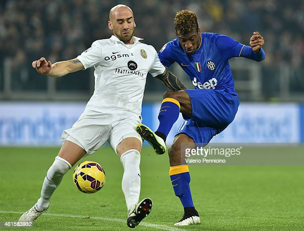 Kingsley Coman of Juventus FC is challenged by Guillermo Daniel Rodriguez of Hellas Verona FC during the TIM Cup match between Juventus FC and Hellas...