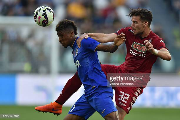 Kingsley Coman of Juventus FC is challenged by Luca Ceppitelli of Cagliari Calcio during the Serie A match between Juventus FC and Cagliari Calcio at...