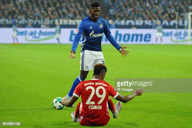 Kingsley Coman of Muenchen and Breel Embolo of Schalke looks on during the Bundesliga match between FC Schalke 04 and FC Bayern Muenchen at...