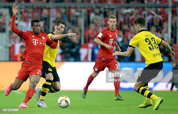Kingsley Coman of Muenchen and Henrikh Mkhitaryan of Dortmund tussle for the ball during the Bundesliga match between FC Bayern Muenchen and Borussia...