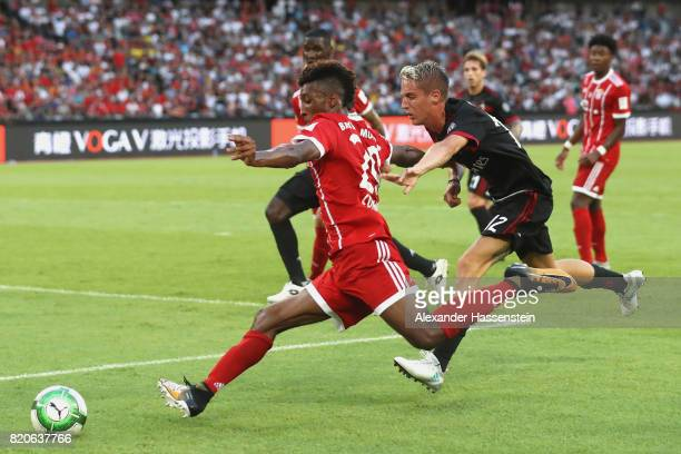 Kingsley Coman of Muenchen battles for the ball with Andrea Conti of Milan during the International Champions Cup Shenzen 2017 match between Bayern...