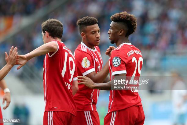 Kingsley Coman of Muenchen celebrates after scoring his team's second goal with Corentin Tolisso and Sebastian Rudy of Muenchen during the DFB Cup...