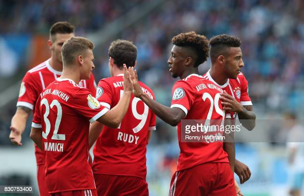 Kingsley Coman of Muenchen celebrates after scoring his team's second goal with Joshua Kimmich Sebastian Rudy and Corentin Tolisso of Muenchen during...