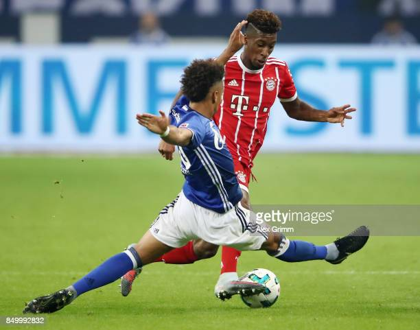 Kingsley Coman of Muenchen is challenged by Thilo Kehrer of Schalke during the Bundesliga match between FC Schalke 04 and FC Bayern Muenchen at...