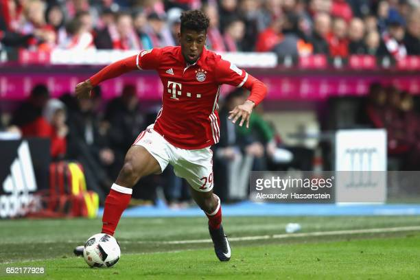 Kingsley Coman of Muenchen runs with the ball during the Bundesliga match between Bayern Muenchen and Eintracht Frankfurt at Allianz Arena on March...
